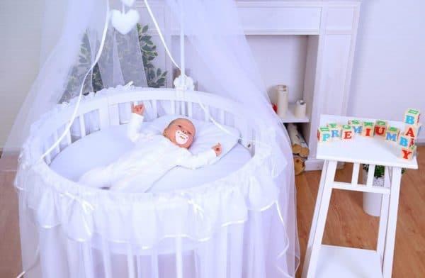 круглая кроватка для новорожденного