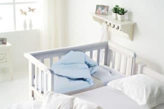 Удобная приставная кроватка для новорожденного